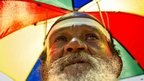 Lee Shinn wears umbrella hat that he sells in Memphis, Tennessee - 6 July
