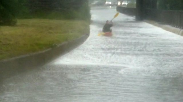 Man canoes down road