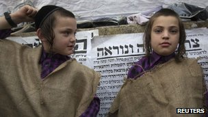 Ultra-Orthodox Jewish boys wear sacks, a symbol of mourning, during a protest against the new conscription proposal. Photo: June 2012