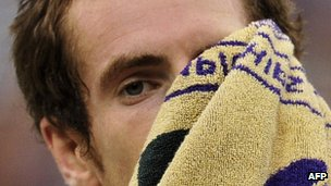 Andy Murray wiping face with Wimbledon towel