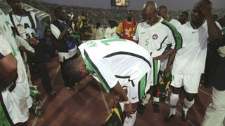 Nigerian players are distraught after their shoot-out loss in the 2000 Nations Cup final