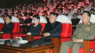 In this image made off North Korea's KRT video footage, North Korean leader Kim Jong Un, second from right, watches performances by North Korea's new Moranbong band in Pyongyang 6 July, 2012