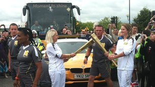 Gail Emms handing over the flame in Milton Keynes