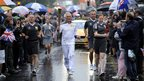Franklyn Keith Musto, a British sailor who won silver in the Flying Dutchman class at the 1964 Olympics in Tokyo, carried the flame in Colchester, 6 July 2012