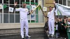 Former swimmer and five-time Olympian Mark Foster (left) ran with the torch in Southend. He took over the flame from Matthew Fletcher.