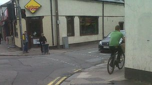 Cyclist on a pavement in Canton, Cardiff