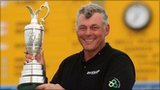 Darren Clarke of Northern Ireland poses with the Claret Jug