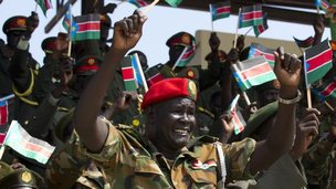 "South Sudanese military wave the national flag celebrating the anniversary of South Sudan""s first Independence day on July 9, 2012 in Juba, South Sudan"