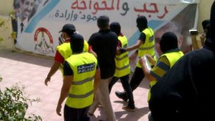 Picture purportedly showing Nabeel Rajab being led away by police from his home (9 July 2012)