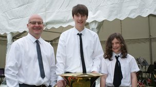 John Powell (left), conductor of the Denbighshire County Brass Band, with band members William Foulkes and Johnny Davies