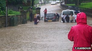 Cars caught in flooding in Mytholmroyd