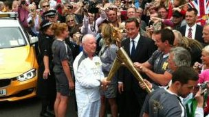 David Cameron and Clive Stone MBE with the torch