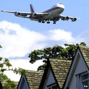 Airliner descending over houses