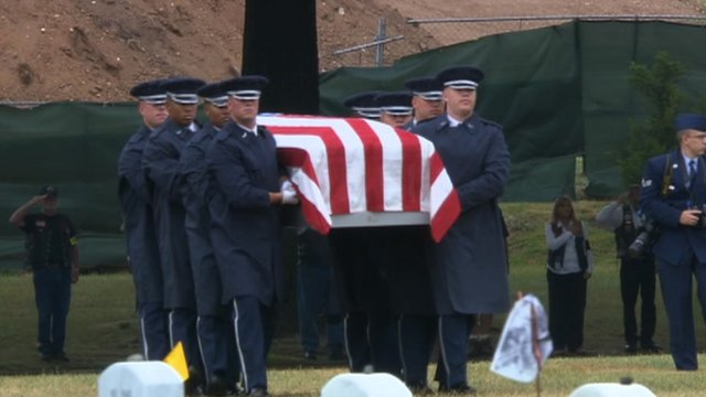 Pallbearers walk remains of Vietnam airmen to grave site