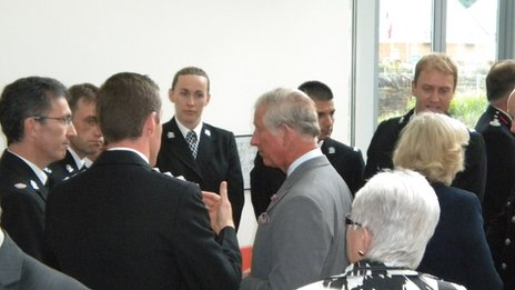 Prince Charles and Duchess of Cornwall speak to police and firefighters