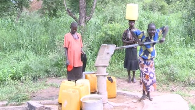 Villagers at water pump