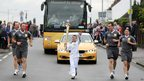 Kieran Jays carrying the Olympic flame