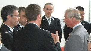 Prince Charles speaking to police