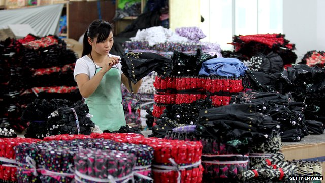 Woman working in umbrella factory in China