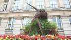 A wicker Usain Bolt in a flower display outside Birmingham Council House