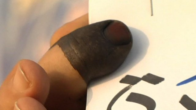Finger of person who has voted in Libya