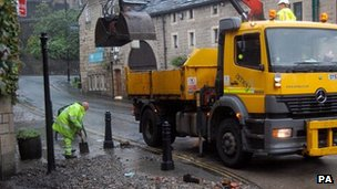 Workers clearing rubble at Hebden Bridge