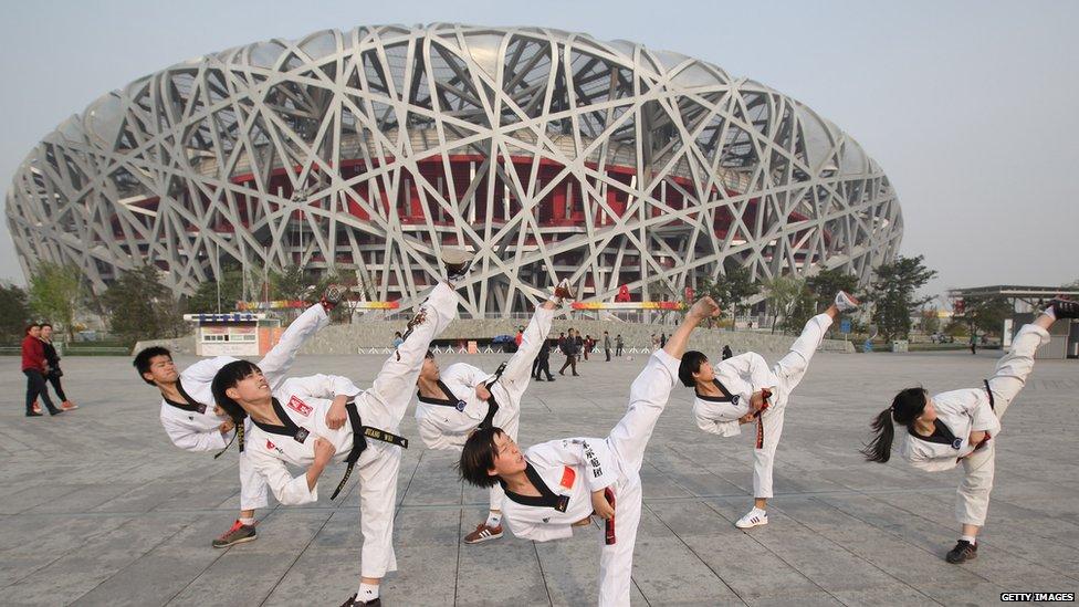 Beijing triumphs with 2008 Olympic bid