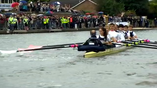 Sir Steve Redgrave and crew row with the Olympic flame