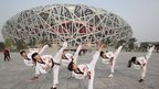 The &quot;Bird&#039;s Nest&quot;, or Beijing National Stadium, photographed in April 2012 as it marked the 100 day countdown to the London Olympics.