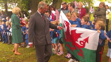 Prince Charles was greeted by school children