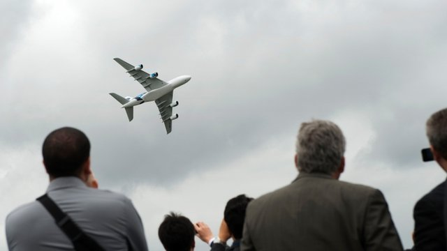 A Malaysian Airlines Airbus A380 takes part in a flying display at the Farnborough International Airshow.