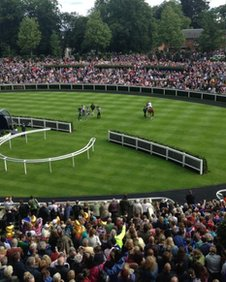 Frankie Dettori carries the Olympic torch at Ascot racecourse