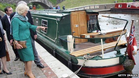 Camilla, Duchess of Cornwall walks along the towpath of the Monmouthshire and Brecon Canal