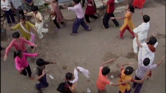 Children dance in the street