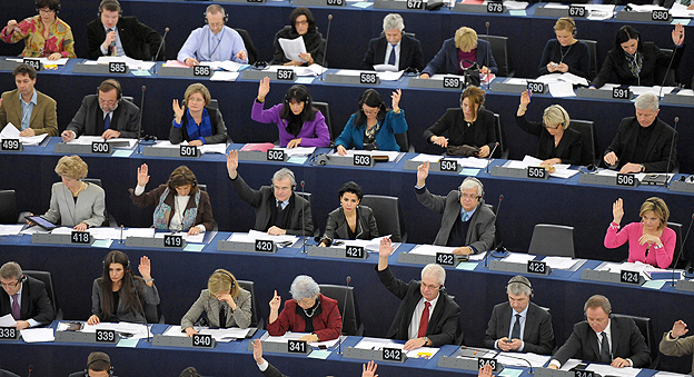 Members of the European Parliament take a vote during a sitting in Strasbourg