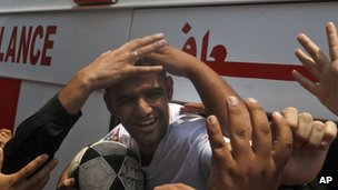Mahmoud Sarsak, a former player with the Palestinian national football team arrives at al-Shifa hospital in Gaza City