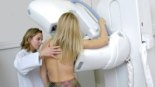 Woman has a breast X-ray (generic)