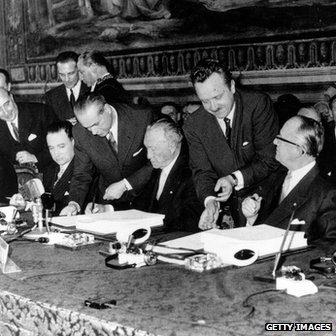 Former West German Chancellor Konrad Adenauer (centre) signs The Treaty of Rome in 1957