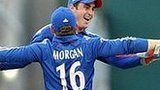 Eoin Morgan and Craig Kieswetter celebrate a wicket
