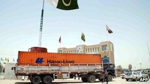 A first container truck crosses the border into the Afghanistan at the Pakistani border town of Chaman 5 July 2012