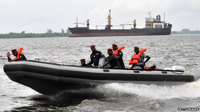 Coast guard officers sit in an inflatable speed boat during a patrol, at the port in Abidjan, on May 29, 2012. The port of Abidjan has acquired two new boats to help its coast guards deter potential threats by pirates.