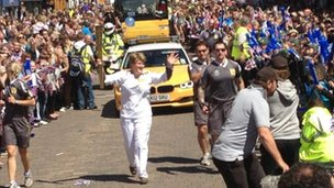 Clare with the torch