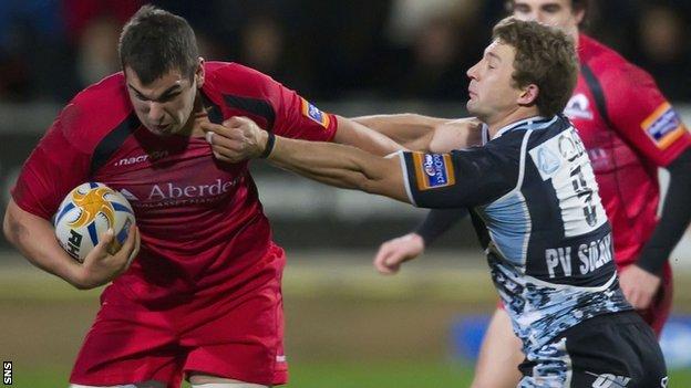 Edinburgh's Stuart McInally is tackled by Chris Cusiter