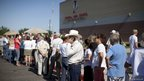 Supporters of Republican presidential candidate, Mitt Romney wait in line