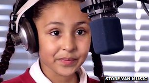 Amani, aged 9, recording vocal for We Say (photo by Glenn Eve)