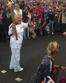 Margie Doherty with the torch