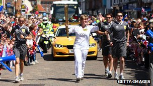 Clare Balding carried the flame in front of packed crowds in Newbury