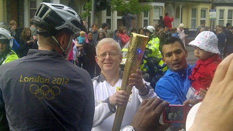 The BBC's Dave Gordon carrying the Olympic torch