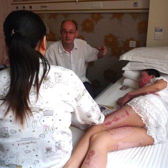 Zhou Yan lies in a hospital bed