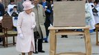 The Queen unveiling a plaque at Hereford Cathedral
